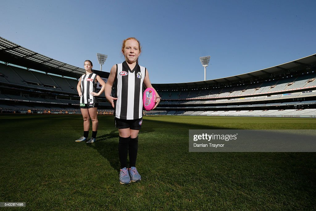 Holly Bate and Chloe Harwick pose for a photo wearing Collingwood Magpies jumpers during an AFL media opportunity to announce the competing teams in next year's inaugural Women's National League at Melbourne Cricket Ground on June 15, 2016 in Melbourne, Australia.