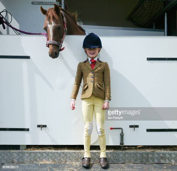 Holly Binks from Dalton poses for a picture with her pony ahead of her event during the Osmotherley Country Show on August 5, 2017 in Osmotherley,...