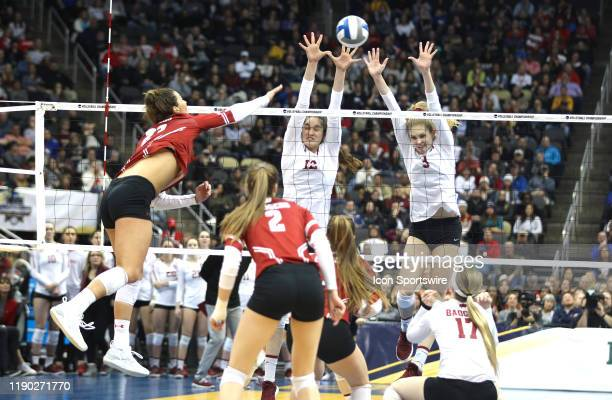 Holly Campbell and Audriana Fitzmorris of the Stanford Cardinal dual block an attack by Molly Haggerty of the Wisconsin Badgers during the NCAA...
