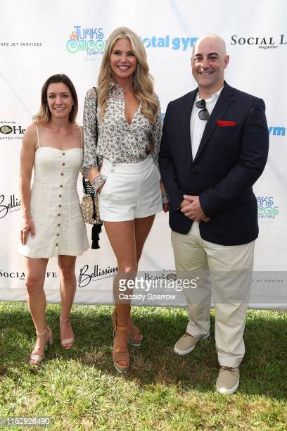 Holly Cloutier Christie Brinkley and John Castelano attend 2019 Polo Hamptons Match Cocktail Party on June 29 2019 in Bridgehampton New York