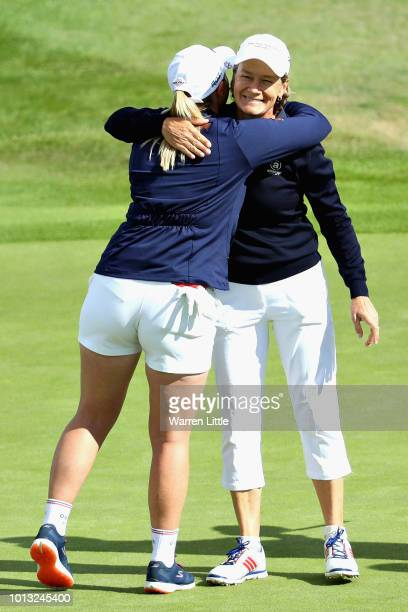 Holly Clyburn and Catriona Matthew of Great Britain embrace on hole sixteen after winning match 1 of Group D during day one of the European Golf Team...