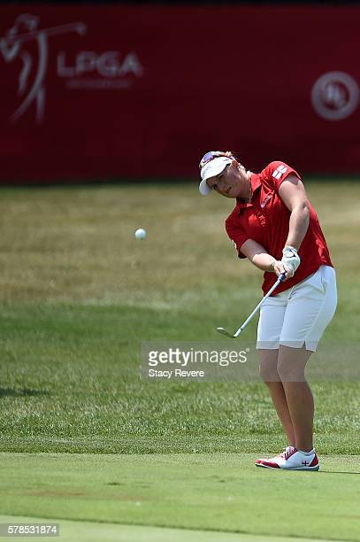 Holly Clyburn of England chips to the 16th green during the fourball session of the 2016 UL International Crown at the Merit Club on July 21 2016 in...