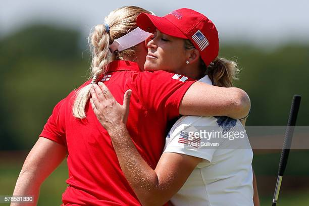 Holly Clyburn of England hugs Cristie Kerr of the United States after England defeated the Unitd States 21 during the fourball session of the 2016 UL...