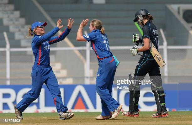Holly Colvin of England celebrates the wicket of Amy Satterthwaite of New Zealand during the 3rd/4th Place PlayOff game between England and New...