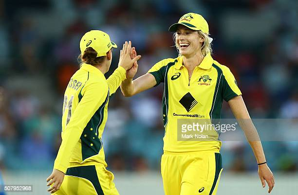 Holly Ferling and Jess Jonassen of Australia celebrate a wicket during game one of the Women's ODI series between Australia and India at Manuka Oval...
