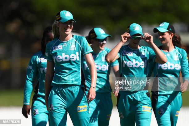 Holly Ferling and the Heat leave the field after the first innings during the Women's Big Bash League match between the Brisbane Heat and the Perth...