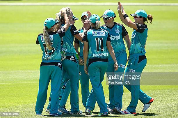 Holly Ferling of the Heat celebrates with team mates after dismissing Nicole Bolton of the Scorchers during the Women's Big Bash League match between...