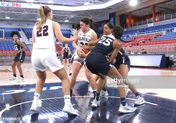 Holly Forbes of the Robert Morris Colonials attempts to steal the ball from Carrie Gross of the Xavier Musketeers during the second half at the UPMC...