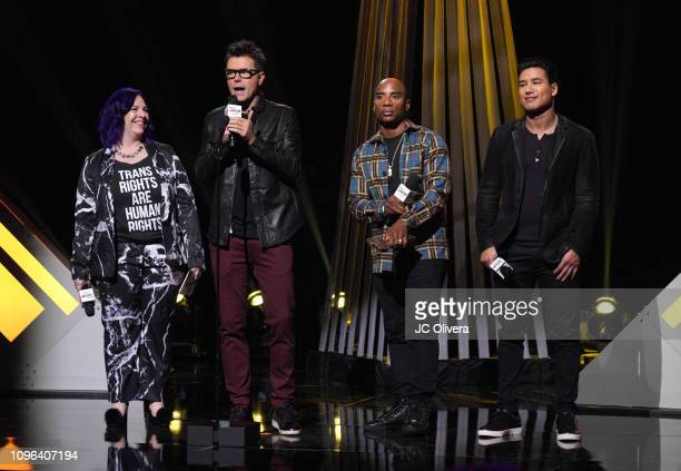 Holly Frey Bobby Bones Charlamagne tha God and Mario Lopez speak onstage during the 2019 iHeartRadio Podcast Awards Presented By Capital One at...