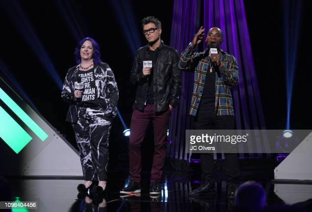 Holly Frey Bobby Bones Charlamagne tha God speak onstage during the 2019 iHeartRadio Podcast Awards Presented By Capital One at iHeartRadio Theater...