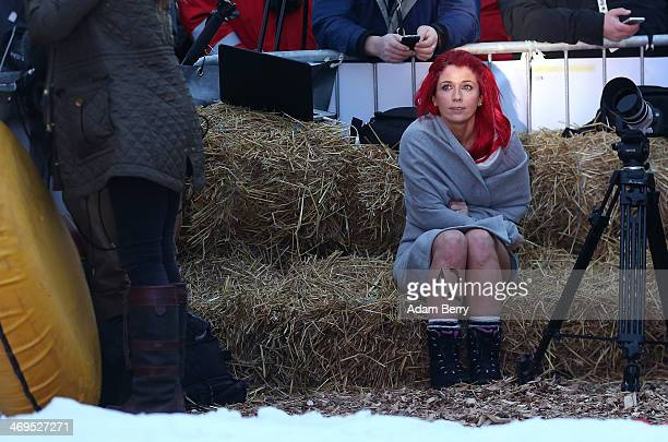 Holly Garshong from the United Kingdom takes a break after finishing her run in the 2014 Naken Sledding World Championships on February 15 2014 in...