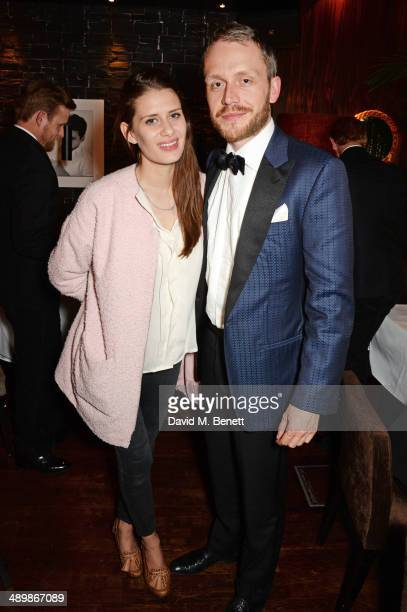 Holly Grace and Mr Hudson attend a private celebratory dinner for Alistair Guy's exhibition 'White Shirts' at The Century Club on May 12 2014 in...
