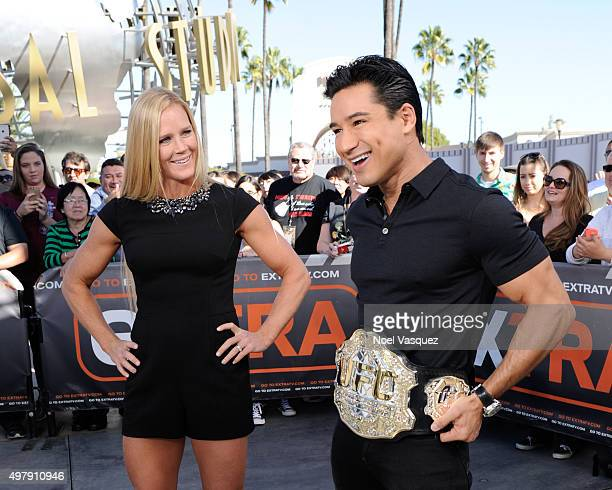 Holly Holm and Mario Lopez poses with a UFC belt at 'Extra' at Universal Studios Hollywood on November 19 2015 in Universal City California