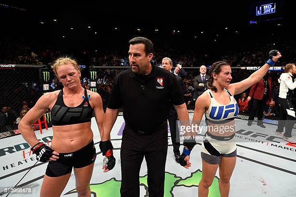 Holly Holm and Miesha Tate await the final decision in their UFC women's bantamweight championship bout during the UFC 196 event inside MGM Grand...