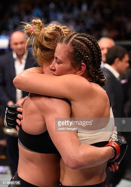 Holly Holm and Miesha Tate embrace after their UFC women's bantamweight championship bout during the UFC 196 event inside MGM Grand Garden Arena on...