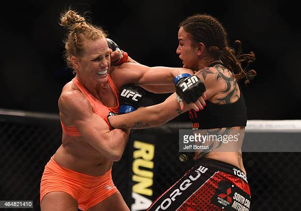 Holly Holm and Raquel Pennington exchange punches in their women's bantamweight bout during the UFC 184 event at Staples Center on February 28 2015...