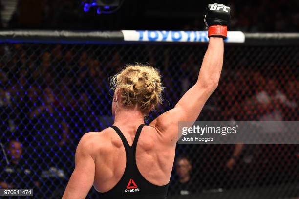 Holly Holm celebrates after defeating Megan Anderson of Australia in their women's featherweight fight during the UFC 225 event at the United Center...