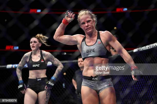 Holly Holm celebrates after her featherweight bout against Megan Anderson of Australia during the UFC 225 Whittaker v Romero 2 event at the United...