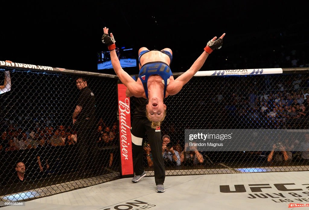 Holly Holm celebrates after her knockout victory over Bethe Correia of Brazil in their women's bantamweight bout during the UFC Fight Night event at the Singapore Indoor Stadium on June 17, 2017 in Singapore.