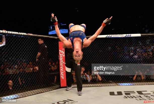 Holly Holm celebrates after her knockout victory over Bethe Correia of Brazil in their women's bantamweight bout during the UFC Fight Night event at...