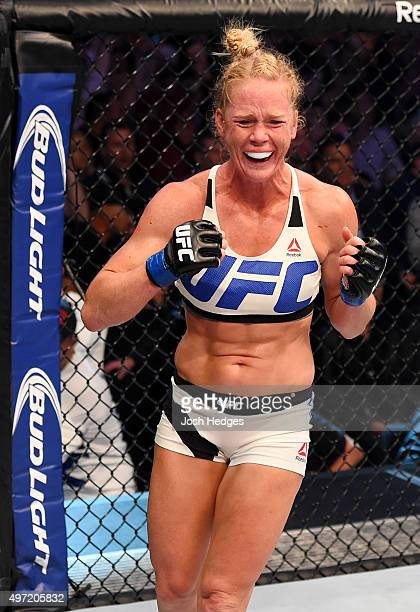 Holly Holm celebrates her second round KO over Ronda Rousey in their UFC women's bantamweight championship bout during the UFC 193 event at Etihad...