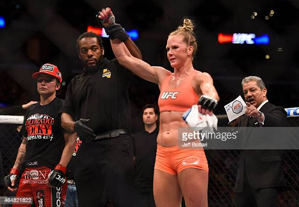 Holly Holm celebrates her win over Raquel Pennington after their women's bantamweight bout during the UFC 184 event at Staples Center on February 28...