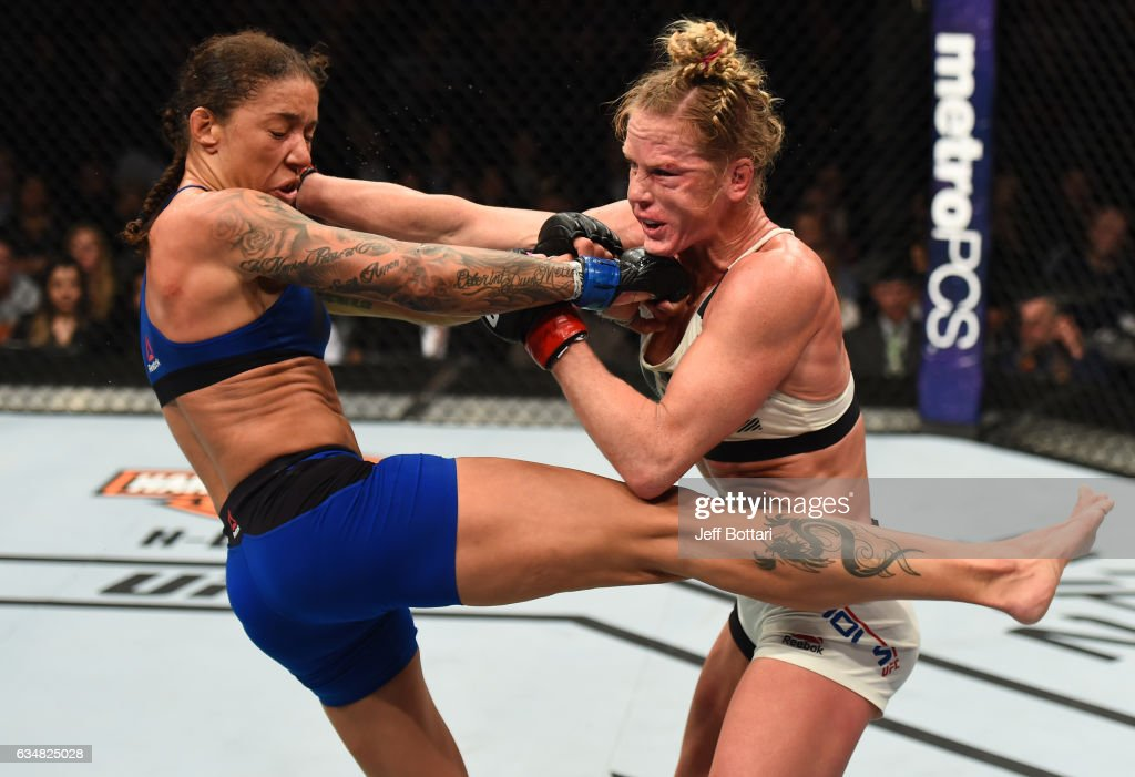 Holly Holm exchanges punches with Germaine de Randamie of The Netherlands in their women's featherweight championship bout during the UFC 208 event inside Barclays Center on February 11, 2017 in Brooklyn, New York.