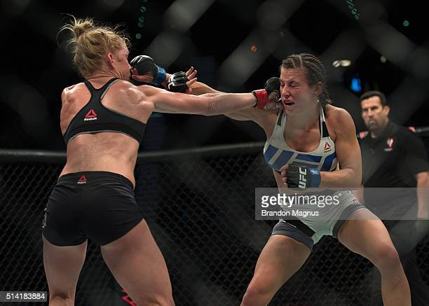 Holly Holm exchanges punches with Miesha Tate during their women's bantamweight championship bout during the UFC 196 in the MGM Grand Garden Arena on...