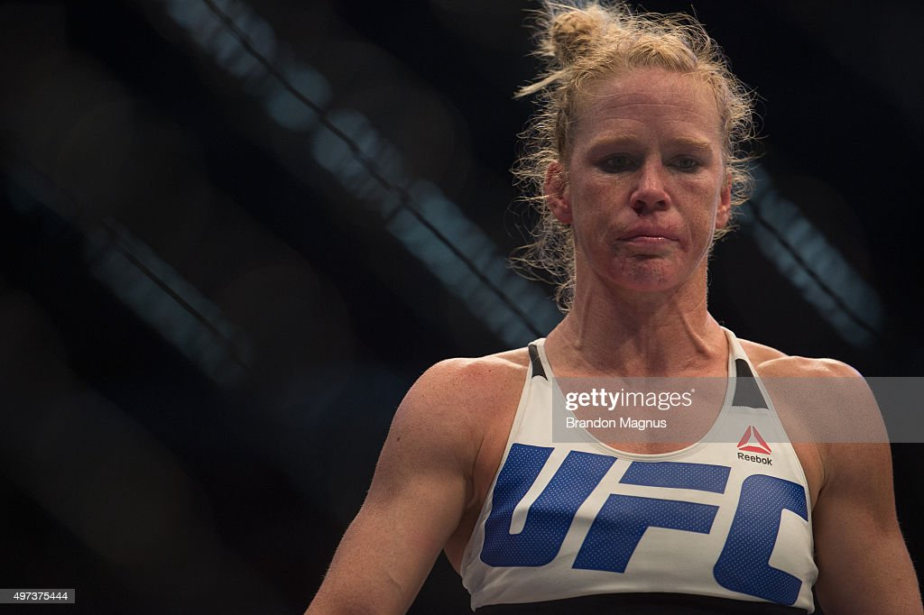Holly Holm heads to her corner after the first round while facing Ronda Rousey in their UFC women's bantamweight championship bout during the UFC 193 event at Etihad Stadium on November 15, 2015 in Melbourne, Australia.