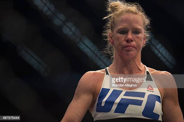 Holly Holm heads to her corner after the first round while facing Ronda Rousey in their UFC women's bantamweight championship bout during the UFC 193...