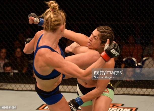 Holly Holm kicks Bethe Correia of Brazil in their women's bantamweight bout during the UFC Fight Night event at the Singapore Indoor Stadium on June...