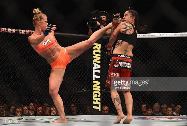Holly Holm kicks Raquel Pennington in their women's bantamweight bout during the UFC 184 event at Staples Center on February 28 2015 in Los Angeles...