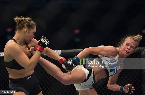 Holly Holm kicks Ronda Rousey in their UFC women's bantamweight championship bout during the UFC 193 event at Etihad Stadium on November 15, 2015 in...