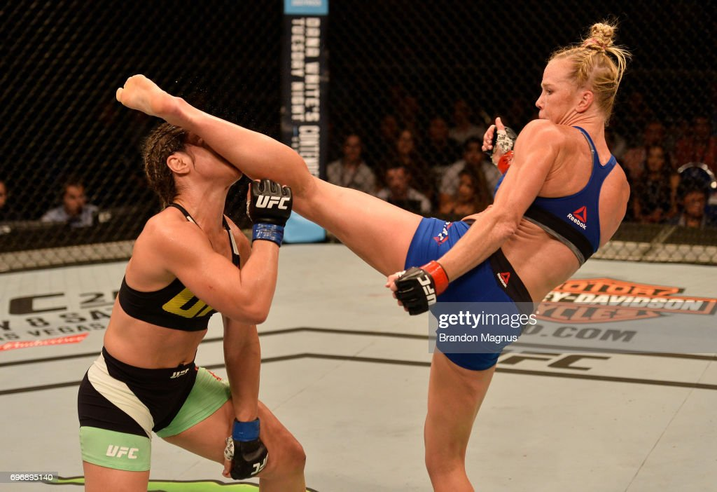 Holly Holm knocks out Bethe Correia of Brazil with a kick in their women's bantamweight bout during the UFC Fight Night event at the Singapore Indoor Stadium on June 17, 2017 in Singapore.
