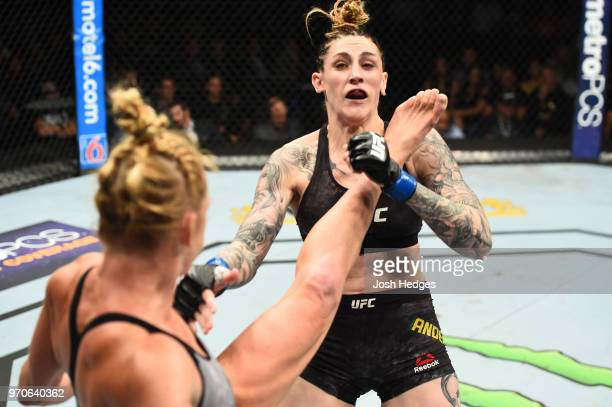 Holly Holm lands a kick to the face of Megan Anderson of Australia in their women's featherweight fight during the UFC 225 event at the United Center...