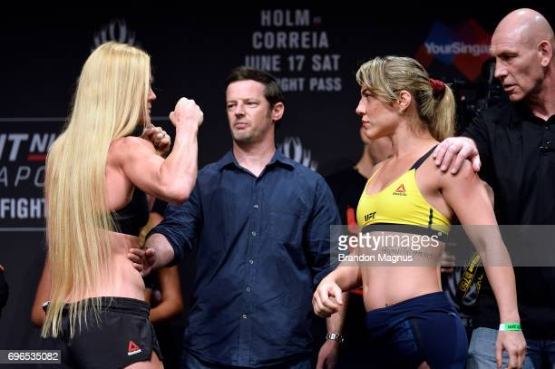 Holly Holm of the United States and Bethe Correia of Brazil face off during the UFC Fight Night weighin at the Marina Bay Sands on June 16 2017 in...