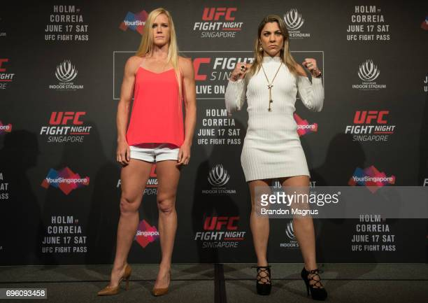 Holly Holm of the United States and Bethe Correia of Brazil pose for a picture during the UFC Fight Night Ultimate Media Day at the Marina Bay Sands...