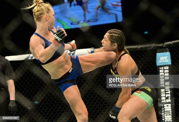 TOPSHOT Holly Holm of the United States competes against Bethe Correia of Brazil during their UFC womens bantamweight event at the UFC Fight Night in...