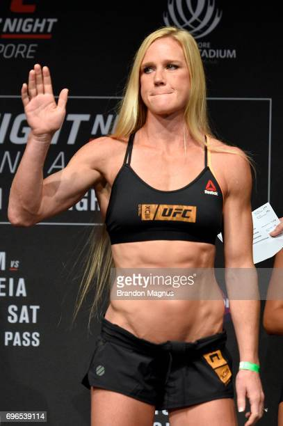 Holly Holm of the United States interacts with the crowd on stage during the UFC Fight Night weighin at the Marina Bay Sands on June 16 2017 in...