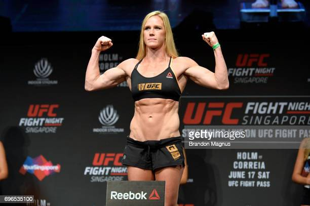 Holly Holm of the United States poses on the scale during the UFC Fight Night weighin at the Marina Bay Sands on June 16 2017 in Singapore