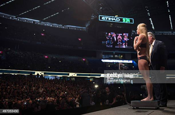 Holly Holm of the United States steps on the scale during the UFC 193 weighin at Etihad Stadium on November 14 2015 in Melbourne Australia