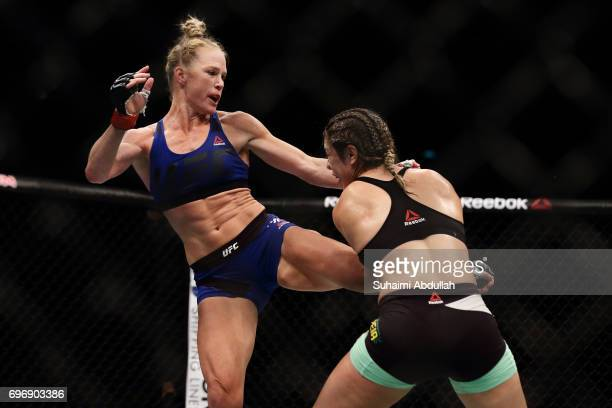 Holly Holm of United States fights Bethe Correia of Brazil in the WomenÕs Bantamweight Main Event Bout during UFC Singapore Fight Night at Singapore...