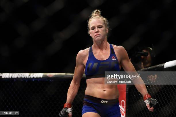 Holly Holm of United States reacts after defeating Bethe Correia of Brazil in the WomenÕs Bantamweight Main Event Bout during UFC Singapore Fight...