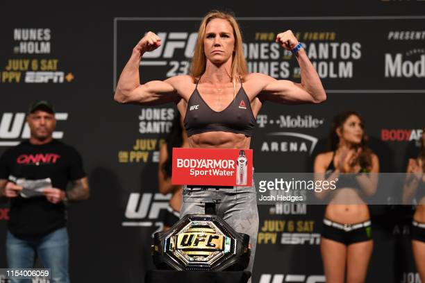 Holly Holm poses on the scale during the UFC 235 weigh-in at T-Mobile Arena on July 5, 2019 in Las Vegas, Nevada.