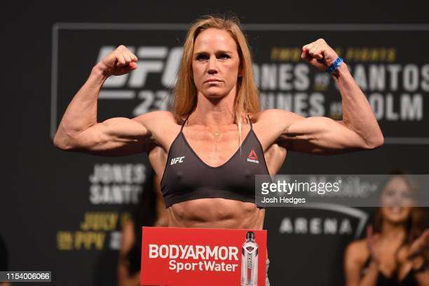 Holly Holm poses on the scale during the UFC 235 weighin at TMobile Arena on July 5 2019 in Las Vegas Nevada