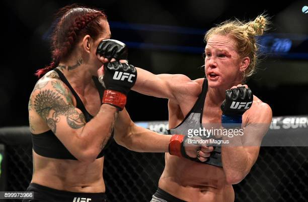 Holly Holm punches Cris Cyborg of Brazil in their women's featherweight bout during the UFC 219 event inside TMobile Arena on December 30 2017 in Las...