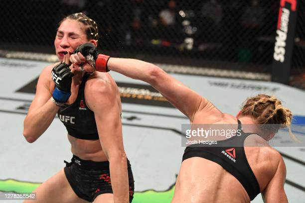 Holly Holm punches Irene Aldana of Mexico in their women's bantamweight bout during the UFC Fight Night event inside Flash Forum on UFC Fight Island...