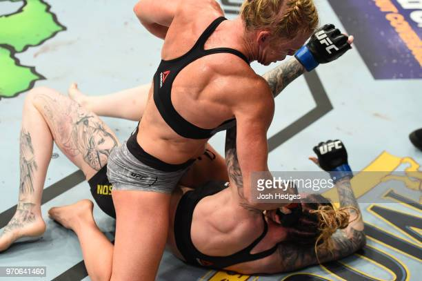 Holly Holm punches Megan Anderson of Australia in their women's featherweight fight during the UFC 225 event at the United Center on June 9 2018 in...