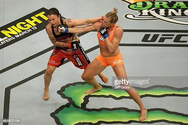 Holly Holm punches Raquel Pennington in their women's bantamweight bout during the UFC 184 event at Staples Center on February 28 2015 in Los Angeles...