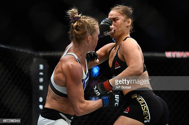 Holly Holm punches Ronda Rousey in their UFC women's bantamweight championship bout during the UFC 193 event at Etihad Stadium on November 15 2015 in...